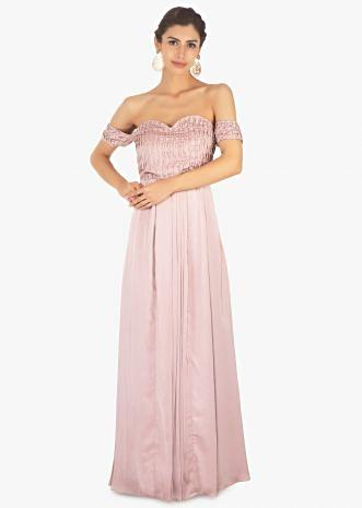 Lavender satin off shoulder gown with pleated bodice and pleats