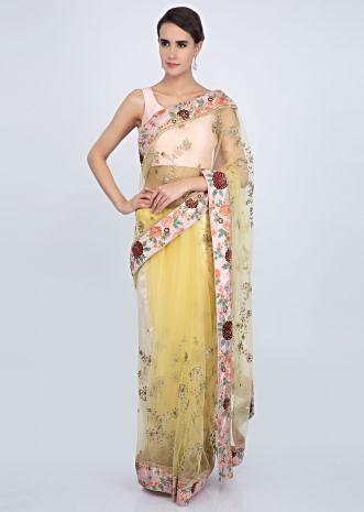 Lemon yellow net saree with contrasting pink raw silk embroidered border only on Kalki