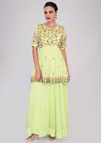 Light green fancy georgette anarkali in layers and peplum style embroidered bodice