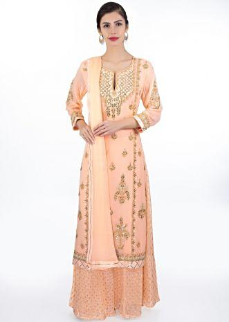 Light peach embroidered georgette suit paired with weaved palazzo and matching chiffon dupatta
