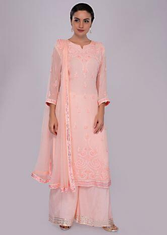 Light peach suit set in self thread embroidered butti and border