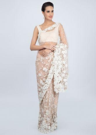 Light pink sheer net saree in white floral jaal embroidery with patch work only on Kalki