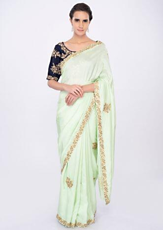 Light pista green satin silk saree with embroidered butti only on kalki
