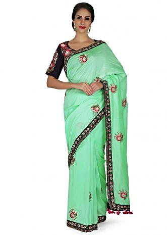 Light green  saree in satin with resham embroidered butti and border only on Kalki