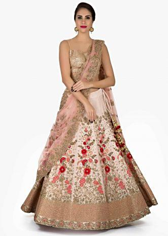 Light pink lehenga in silk with a net dupatta embellished in resham and zardosi work only on Kalki