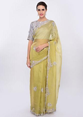 Lime green organza saree with contrasting grey blouse only on Kalki