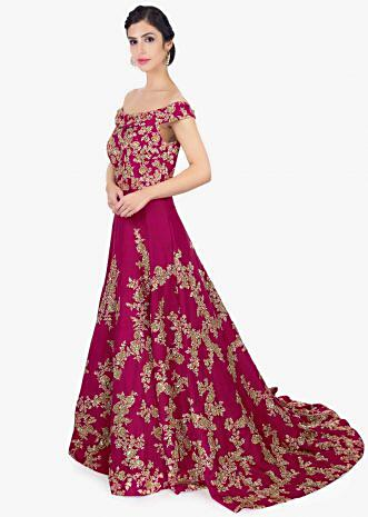 Magenta raw silk embroidered gown with trail at the back