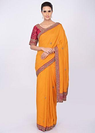 Mango yellow silk saree with embroidered butti and border only on kalki