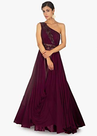 Maroon one shoulder satin gown with ruching bodice along with 3 D potli buttons