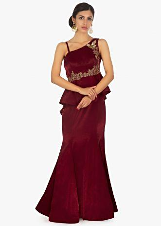 Maroon  one side strap gown in peplum style embellished in bird and floral motif