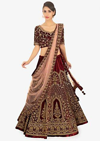 Maroon velvet lehenga wth pink embroidered butti and bordered dupatta