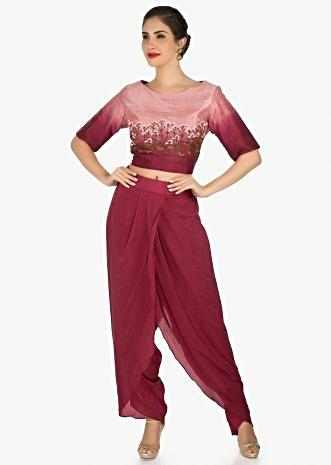 Maroon dhoti suit in raw silk is embellished with french knot in floral motifs only on Kalki