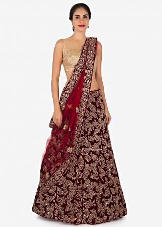 Maroon lehenga in velvet embellished in cut dana and kundan embroidery only on Kalki