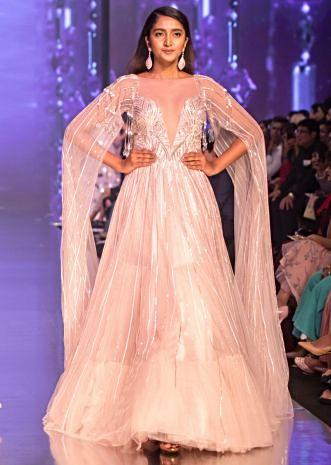 3ee450f1e2 Mauve pink sheer net gown with long extended net flared sleeves only on  Kalki ...