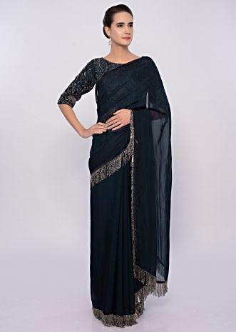 Mid night blue organza saree with tasseled pallo and border only on Kalki