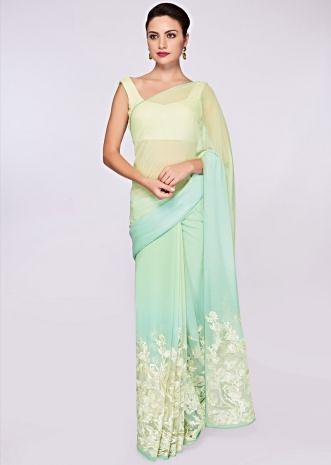 Mint blue and green shaded georgette saree with net embroidered bottom