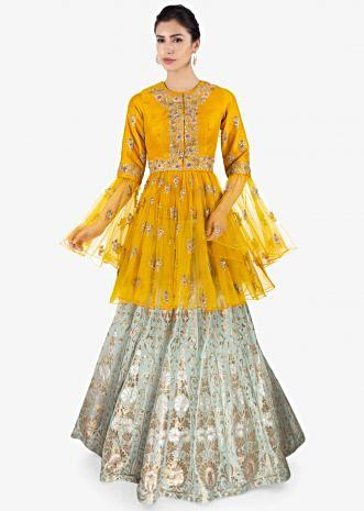 Mint green brocade  lehenga paired with  mustard thigh length long top