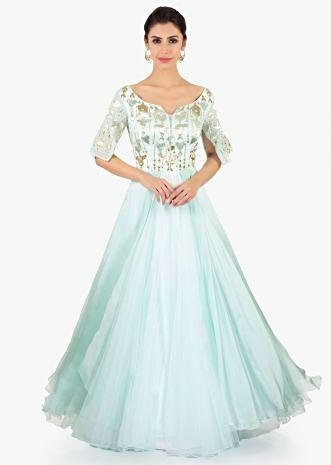 Mint green gown designed with over lapping sleeves and layers