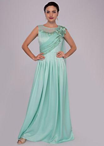 Mint green gown with floral embroidery and pleated bodice