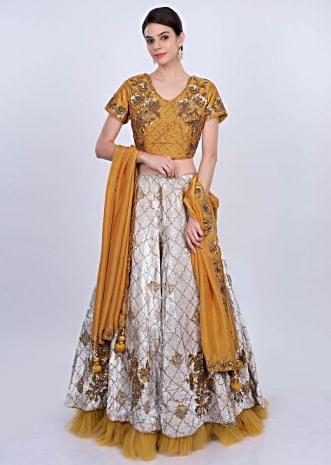 Mint green heavy velvet lehenga wit mustard yellow embroidered blouse and dupatta only on Kalki