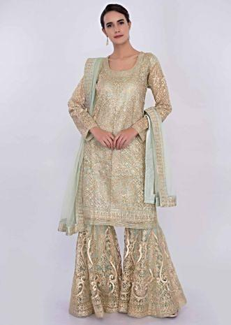Mint green net sharara suit in lace jaal embroidery only on Kalki