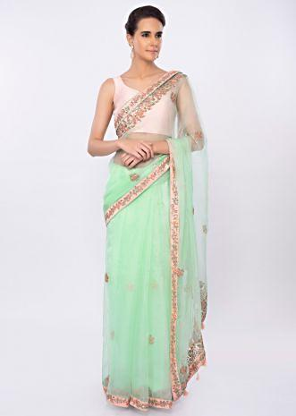Mint green organza saree in floral embroidery and butti only on kalki