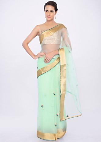 Mint green organza saree with floral butti only on kalki