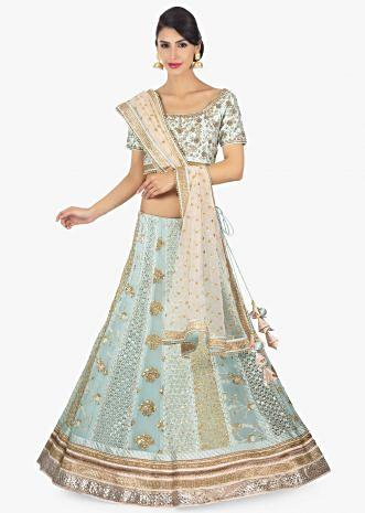 Mint green raw silk blouse paired with georgette lehenga in alternate kali along with a cream net dupatta