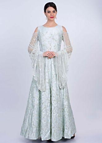 Mint heavy flared gown with its fancy cold shoulder with extended net sleeves only on Kalki