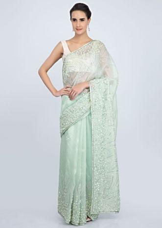 Mint organza saree with embroidered butti and border only on Kalki