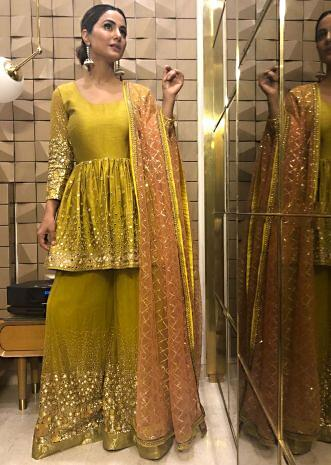 Mirror embridered suit and palazzo with contrasting peach net dupatta