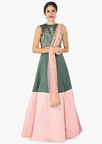 Moss green and pink satin lehenga with a matching crop top and pink net dupatta