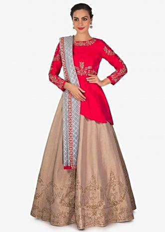 Mud brown lehenga in raw silk with rani pink embroidered blouse only on Kalki
