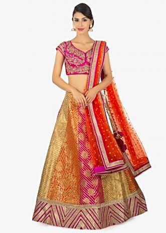 Multi color brocade lehange  paired with a fusia pink silk blouse and rust net dupatta