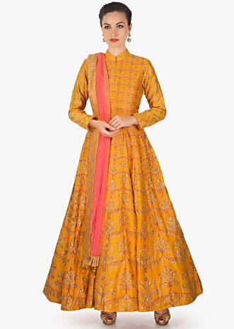 Mustard Pink cotton silk anarkali paired with a Pink net dupatta and lycra chudidar only on kalki