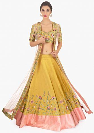 Mustard raw silk lehenga and blouse paired long net jacket