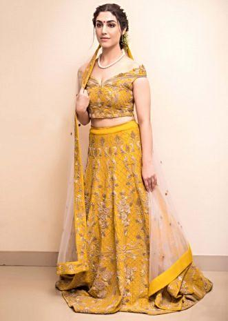 Mustard raw silk lehenga set in heavy embroidery