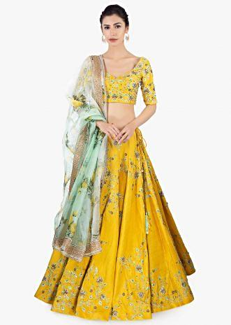 Mustard raw silk lehenga set paired with a green organza dupatta