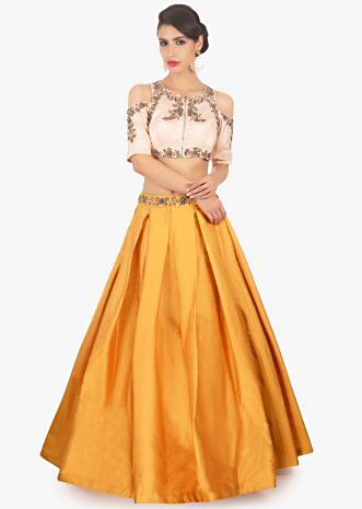 Mustard skirt paired with light peach cold shoulder crop top