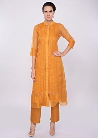 Mustard yellow three piece suit designed with pleats only on Kalki