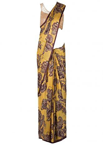 Mustard and brown saree in satin with floral and paisley print only on Kalki