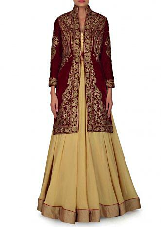 Mustard strapless gown in with maroon velvet jacket only on Kalki