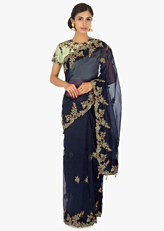 Navy blue organza saree  paired with a contrasting Pista green raw silk blouse