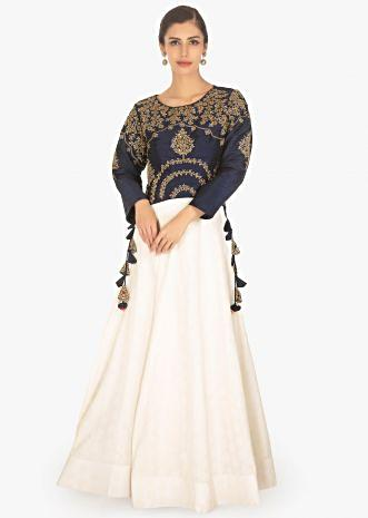 Navy Blue raw silk top paired with off white jacquard skirt
