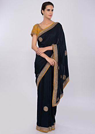 Navy blue silk saree with embroidered mustard blouse only on kalki