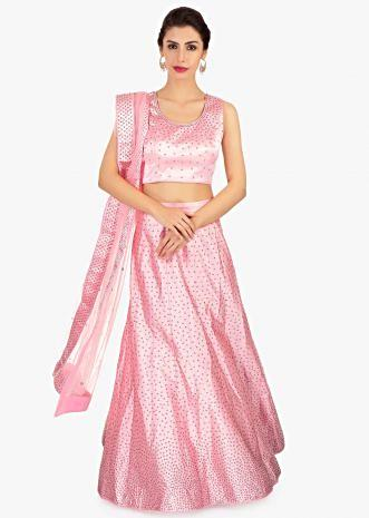Neon pink crepe satin lehenga set paired with matching pink net blouse