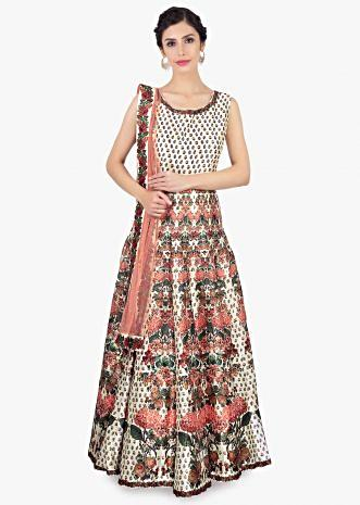 Off white anarkali dress in digital floral print paired with a peach net dupatta