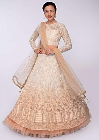 Off white and peach shade lehenga set in thread embroidery only on Kalki