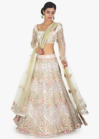 Off white embellished satin net lehenga and  blouse paired with a light green net dupatta