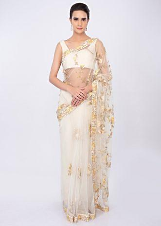 Off white net saree with floral embroidery and butti only on kalki